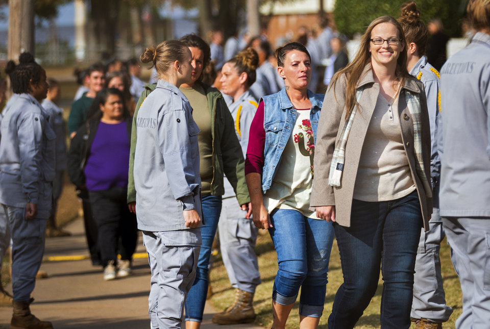 Photo - Julie Faircloth smiles as she leads the first group of women out of the Dr. Eddie Warrior Correctional Facility on Monday, Nov. 4, 2019 in Taft, Okla. Governor Kevin Stitt greeted an estimated 70 women whose sentences he commuted from the facility. [Chris Landsberger/The Oklahoman]