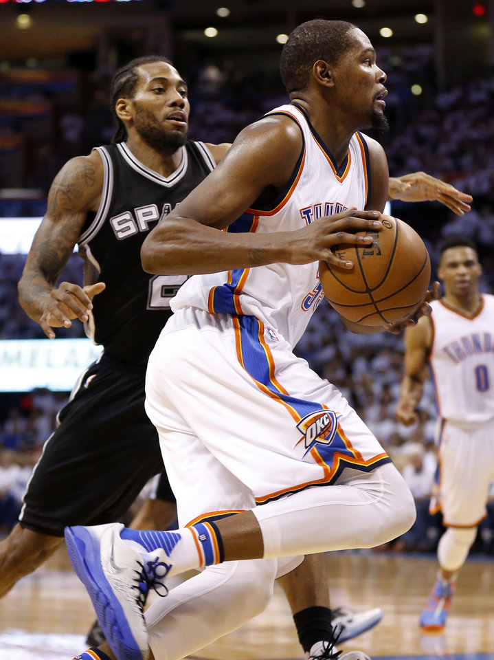 Photo - Oklahoma City's Kevin Durant (35) drives against San Antonio's Kawhi Leonard (2) during Game 4 of the Western Conference semifinals between the Oklahoma City Thunder and the San Antonio Spurs in the NBA playoffs at Chesapeake Energy Arena in Oklahoma City, Sunday, May 8, 2016. Photo by Nate Billings, The Oklahoman