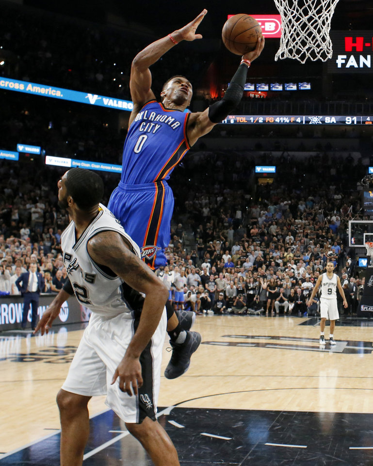 Photo - Oklahoma City's Russell Westbrook (0) makes a basket and is fouled beside San Antonio's LaMarcus Aldridge (12) in the final seconds of Game 5 of the second-round series between the Oklahoma City Thunder and the San Antonio Spurs in the NBA playoffs at the AT&T Center in San Antonio, Tuesday, May 10, 2016. Oklahoma City won 95-91. Photo by Bryan Terry, The Oklahoman