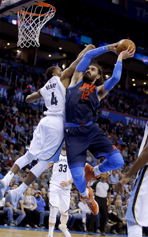 Photo -  Oklahoma City's Steven Adams, right, goes up for a shot while Memphis' Myke Henry defends during Sunday night's game at Chesapeake Energy Arena. [PHOTO BY SARAH PHIPPS, THE OKLAHOMAN]