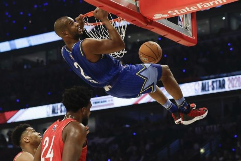 Photo - Chris Paul of the Oklahoma City Thunder dunks during the first half of the NBA All-Star basketball game Sunday, Feb. 16, 2020, in Chicago. (AP Photo/Nam Huh)
