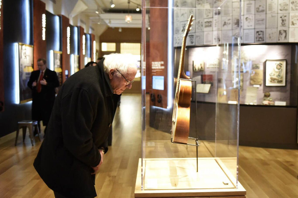 Photo - Bernie Sanders observing the Woody Guthrie collection and archives at the Woody Guthrie Center in downtown Tulsa. [Photo via berniesanders.com]
