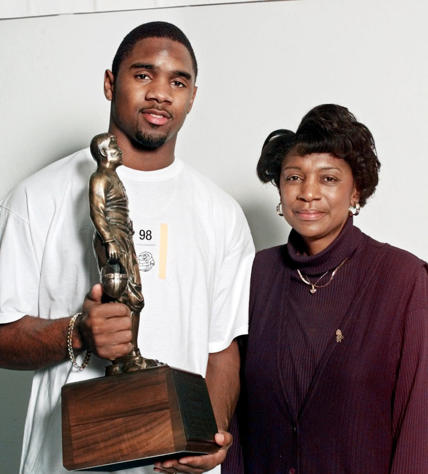 Photo - Charles Woodson holds the Jim Thorpe Award with his mother, Georgia Woodson.