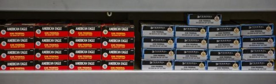 Photo -  Boxes of ammo are shown on the shelves at H&H Shooting Sports. [CHRIS LANDSBERGER/THE OKLAHOMAN]