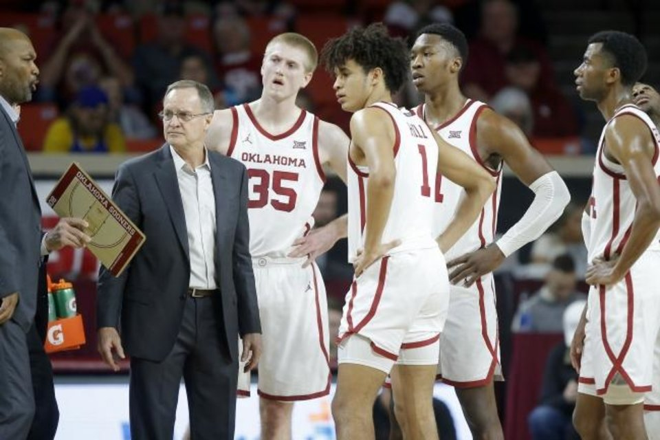 Photo - Oklahoma coach Lon Kruger stands beside his team during an NCAA mens college basketball game between the University of Oklahoma Sooners (OU) and the West Virginia Mountaineers at the Lloyd Noble Center in Norman, Okla.,Saturday, Feb. 8, 2020. Oklahoma won 69-59. [Bryan Terry/The Oklahoman]