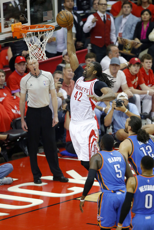 Photo - Houston's Nene Hilario (42) goes up for a dunk during Game 2 in the first round of the NBA basketball playoffs between the Oklahoma City Thunder and the Houston Rockets at the Toyota Center in Houston, Texas,  Wednesday, April 19, 2017.  Photo by Sarah Phipps, The Oklahoman