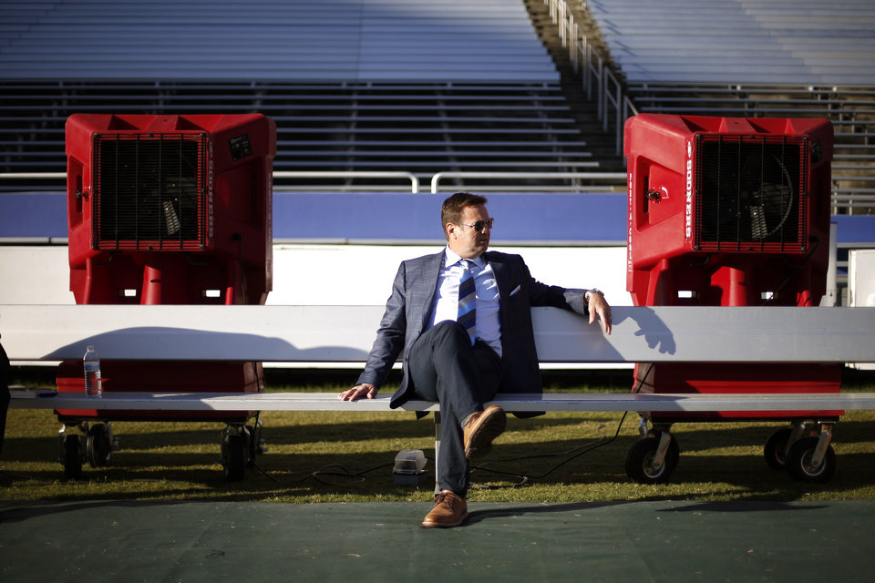 Photo - Oklahoma coach Bob Stoops sits on a bench inside the Cotton Bowl Stadium after arriving before the Red River Showdown college football game between the University of Oklahoma Sooners (OU) and the Texas Longhorns (UT) at Cotton Bowl Stadium in Dallas, Saturday, Oct. 8, 2016. Photo by Bryan Terry, The Oklahoman