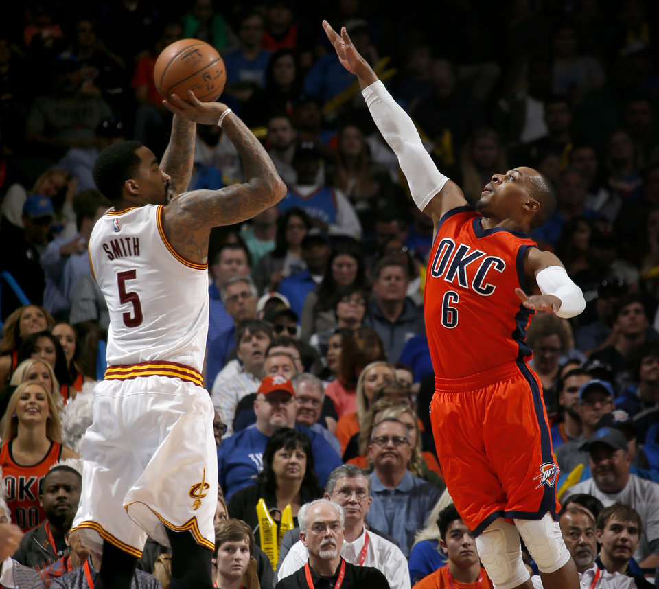 Photo - Oklahoma City's Randy Foye (6) defends Cleveland's J.R. Smith (5) during an NBA basketball game between the Oklahoma City Thunder and the Cleveland Cavaliers at Chesapeake Energy Arena in Oklahoma City, Sunday, Feb. 21, 2016. Photo by Bryan Terry, The Oklahoman