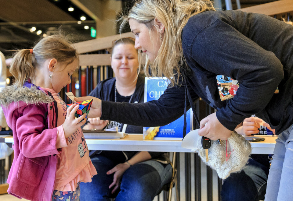 Photo - Sarah Garrison put the name tag on her daughter Avery as she drops her off for the day camp at Science Museum Oklahoma in Oklahoma City, Okla. on Monday, April 2, 2018.  The camps are available for state students that are out of school during the teacher walkout.   Photo by Chris Landsberger, The Oklahoman