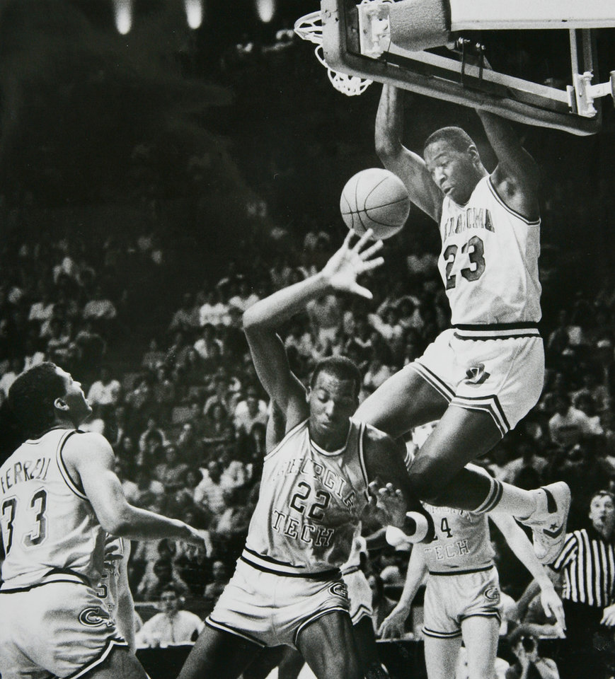 Photo - Former OU basketball player Wayman Tisdale. Sooner Wayman Tisdale (23) makes it no contest against Yellowjacket John Salley(22) during Sunday's comeback victory in Norman. Photo taken 3/3/1985, published 3/4/1985 in The Daily Oklahoman   Staff Photo by Jim Beckel ORG XMIT: KOD