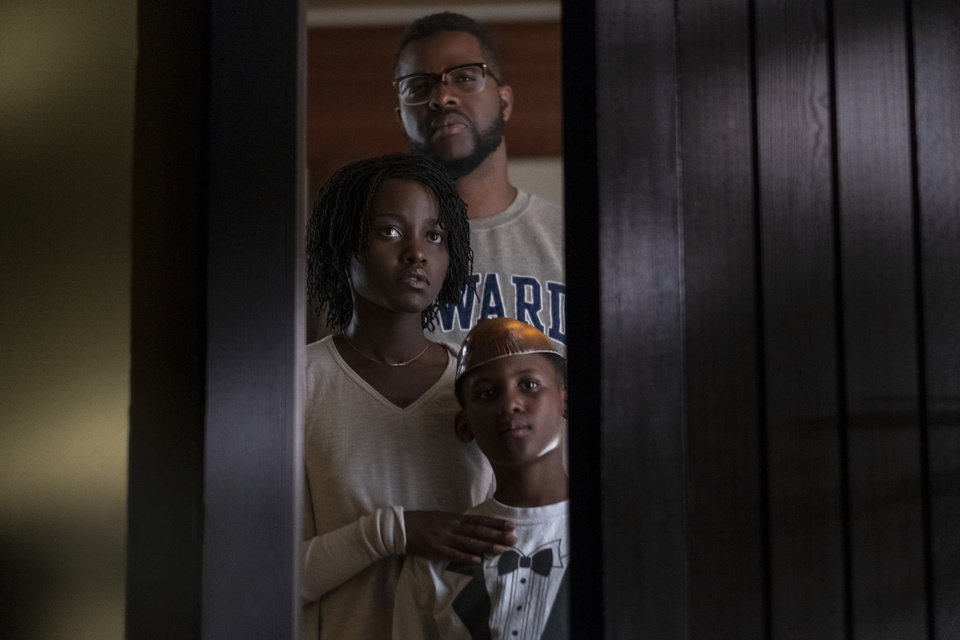 "Photo - This image released by Universal Pictures shows Winston Duke, Lupita Nyong'o and Evan Alex, right, in a scene from ""Us,"" written, produced and directed by Jordan Peele. (Claudette Barius/Universal Pictures via AP)"