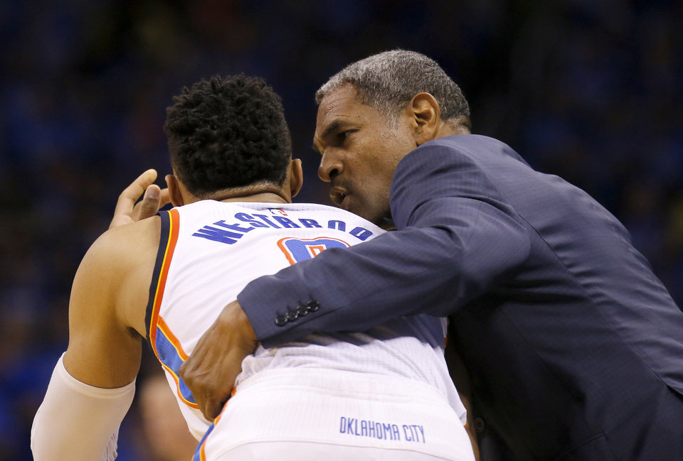 Photo - Assistant coach Mo Checks talks to Oklahoma City's Russell Westbrook (0) during Game 6 of the Western Conference finals in the NBA playoffs between the Oklahoma City Thunder and the Golden State Warriors at Chesapeake Energy Arena in Oklahoma City, Saturday, May 28, 2016. Photo by Sarah Phipps, The Oklahoman