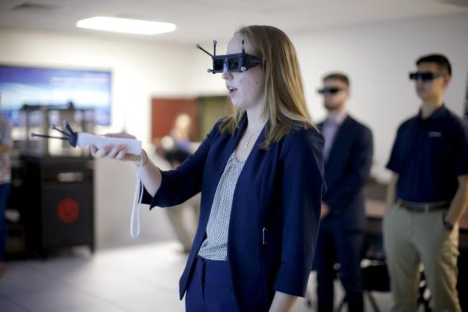 Photo -  Boeing intern Yana Tatgenhorst on Thursday demonstrates the IC. IDO virtual reality system for other interns at Boeing's Oklahoma City office. [BRYAN TERRY/THE OKLAHOMAN]