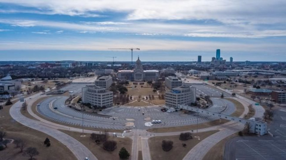 Photo -  Oklahoma could see its highest number of unemployment benefit claims this week in nearly three decades. Oklahoman's are filing for unemployment benefits in droves as layoffs continue throughout the state largely due to the outbreak of the coronavirus. Drone image of the Oklahoma State Capitol building. Image by Dave Morris.