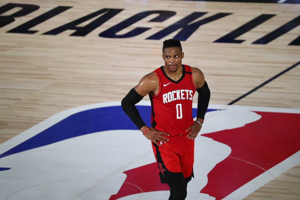 Photo - Aug 11, 2020; Lake Buena Vista, Florida, USA; Houston Rockets guard Russell Westbrook (0) looks on from center court during the first half of a NBA basketball game against the San Antonio Spurs at The Field House. Mandatory Credit: Kim Klement-USA TODAY Sports