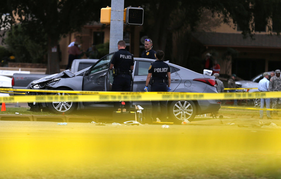 Photo - Law enforcement investigates the scene of a fatality accident during the Oklahoma State University homecoming parade at the intersection of Main and Hall of Fame, Saturday, October 24, 2015, in Stillwater, Okla. Photo by Sarah Phipps, The Oklahoman
