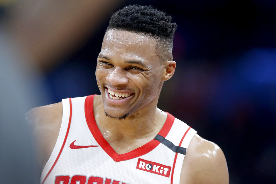 Photo - Houston's Russell Westbrook (0) smiles after talking with Oklahoma City coach Billy Donovan during an NBA basketball game between the Oklahoma City Thunder and Houston Rockets at Chesapeake Energy Arena in Oklahoma City, Thursday, Jan. 9, 2020. [Bryan Terry/The Oklahoman]
