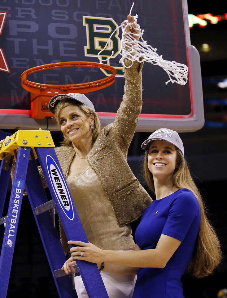 Photo - Baylor coach Kim Mulkey waves the net with her daughter Makenzie Fuller, assistant director of basketball operations, after the Big 12 Women's Basketball Championship final between the Texas Longhorns and the Baylor Lady Bears at Chesapeake Energy Arena in Oklahoma City, Monday, March 7, 2016. Baylor won 79-63. Photo by Nate Billings, The Oklahoman