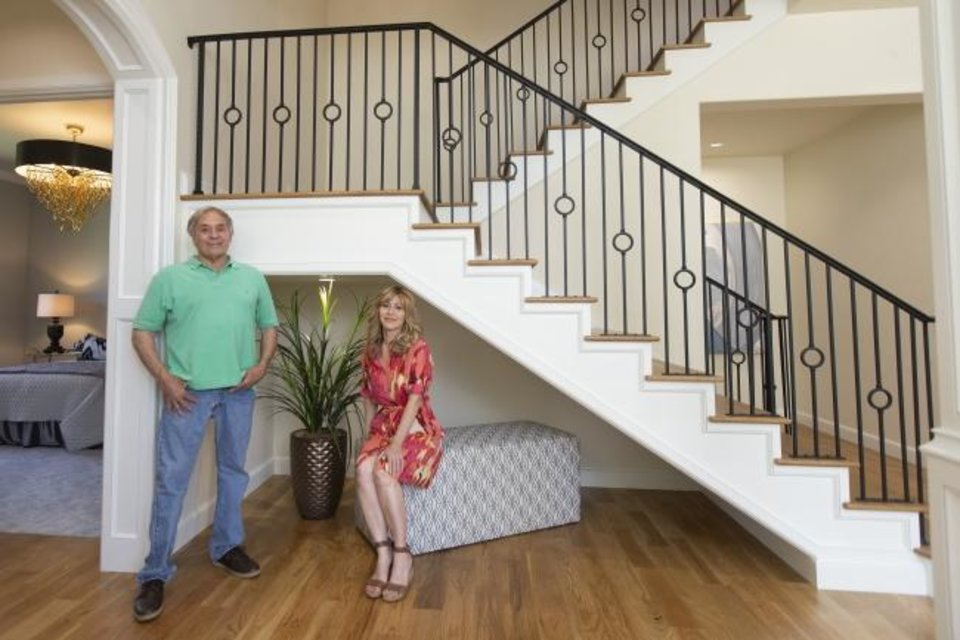 Photo -  Developer David Yost and designer-real estate agent Joyce Brown pose in what they call