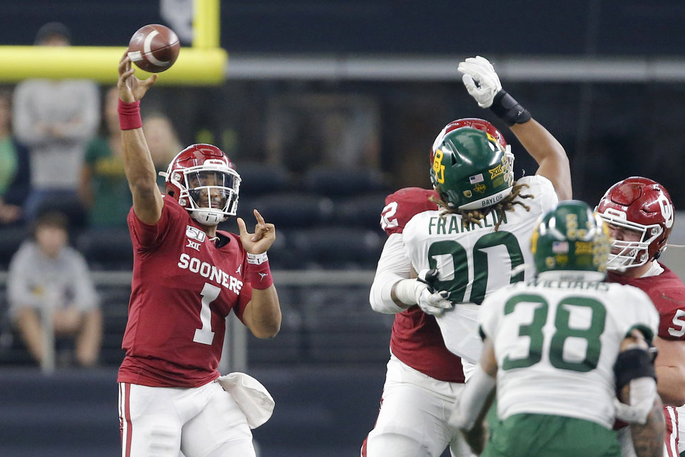 Photo - Oklahoma's Jalen Hurts (1) throws a pass during the Big 12 Championship Game between the University of Oklahoma Sooners (OU) and the Baylor University Bears at AT&T Stadium in Arlington, Texas, Saturday, Dec. 7, 2019. Oklahoma won 30-23. [Bryan Terry/The Oklahoman]