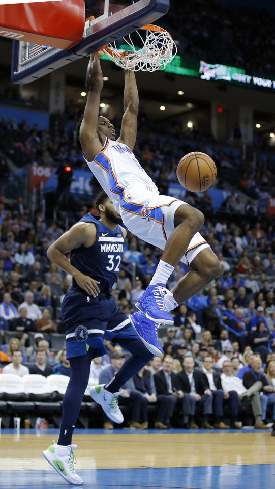 Photo - Oklahoma City's Hamidou Diallo (6) dunks in front of Minnesota's Karl-Anthony Towns (32) during the NBA game between the Oklahoma City Thunder and Minnesota Timberwolves at the Chesapeake Energy Arena, Tuesday, Jan. 8, 2019. Photo by Sarah Phipps, The Oklahoman