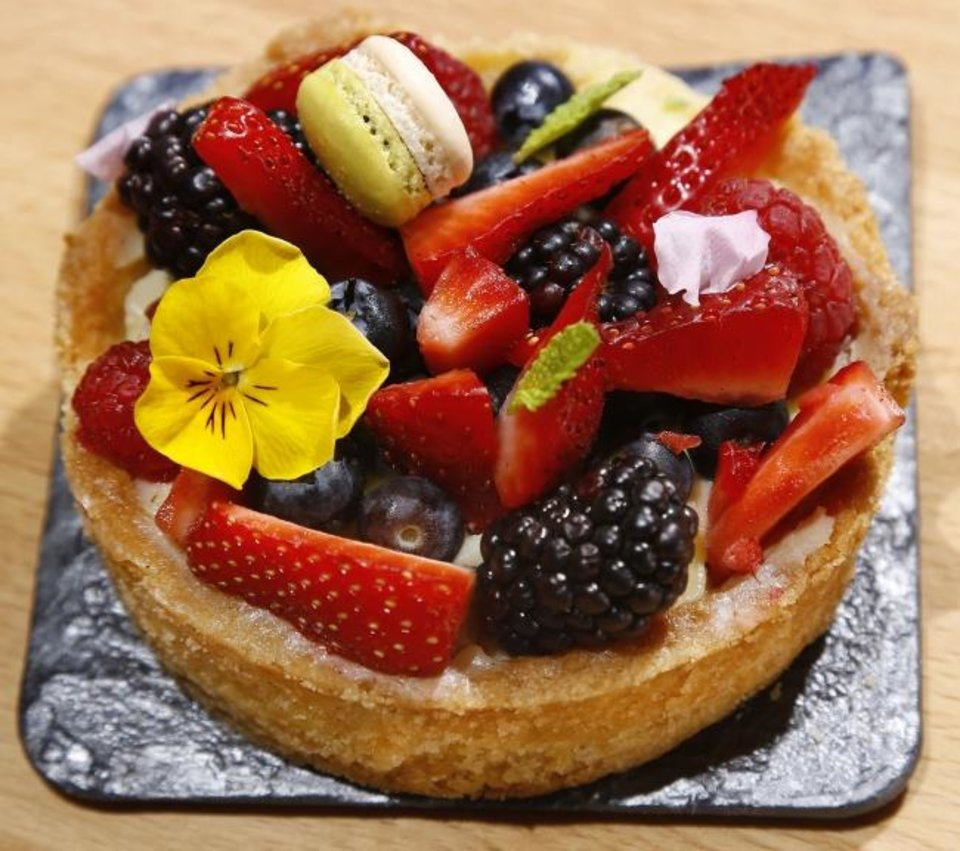Photo -  A fruit tart made with sable vanilla bean pastry cream, fresh berries and kiwi jam is on display at Ganache Patisserie. [Jim Beckel/The Oklahoman]