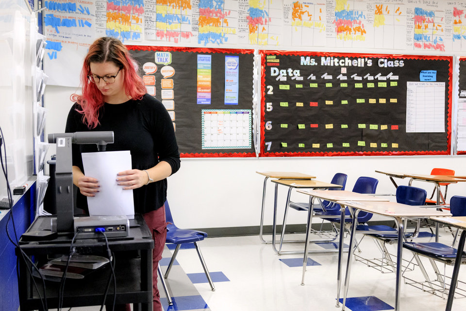 Photo - File photo: Seventh grade math teacher Morgan Mitchell prepares her lesson plan while in her classroom at Roosevelt Middle School in Oklahoma City, Okla. on Monday, April 16, 2018. [The Oklahoman archives]