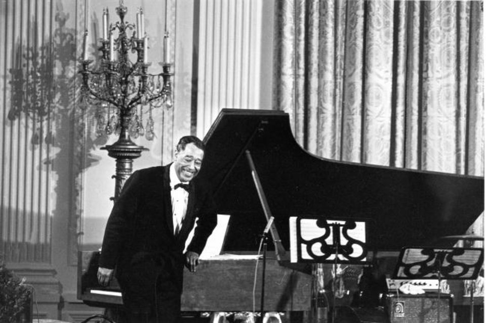 Photo -  Jazz pianist Duke Ellington is seen on April 29, 1969, in the East Room of the White House.  [AP File Photo/Harvey Georges]