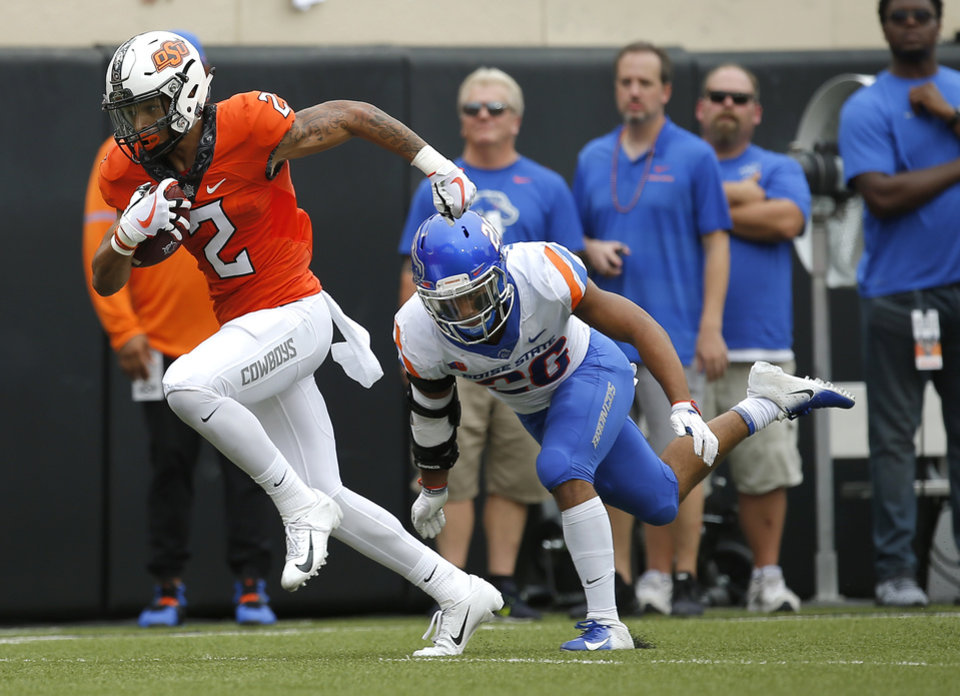 Photo - Oklahoma State's Tylan Wallace (2) runs after a reception as Boise State's Avery Williams (26) defends during a college football game between the Oklahoma State Cowboys (OSU) and the Boise State Broncos at Boone Pickens Stadium in Stillwater, Okla., Saturday, Sept. 15, 2018. OSU won 44-21. Photo by Sarah Phipps, The Oklahoman