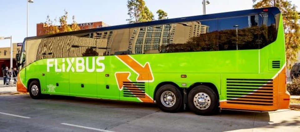 Photo -  A FlixBus is displayed Wednesday during an announcement ceremony of the new transit option for Oklahoma City at the Santa Fe Depot in Oklahoma City.  [Chris Landsberger/The Oklahoman]