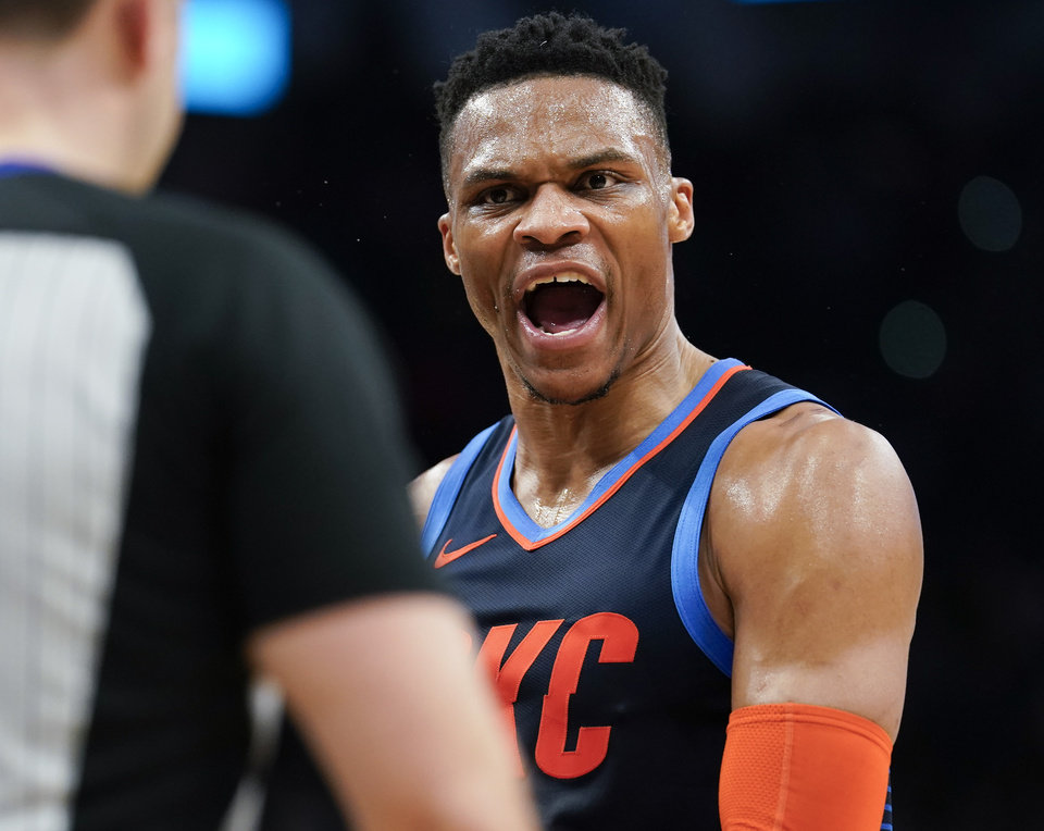Photo - Oklahoma City Thunder's Russell Westbrook, right, yells at a referee after being called for a technical foul during the first half of an NBA basketball game against the San Antonio Spurs, Saturday, March 2, 2019, in San Antonio. (AP Photo/Darren Abate)