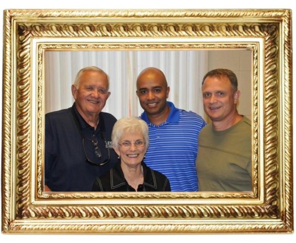 Photo -  Legendary high school basketball coach Dub Raper, left, won hundreds of games during his four-decade-long career. But his proudest accomplishment was when men who he coached became coaches. Among them was Lenny Hatchett, middle, pictured with Raper's wife, Jackie, and middle son, Scott. Raper considered his players as part of his family. [PHOTO PROVIDED]