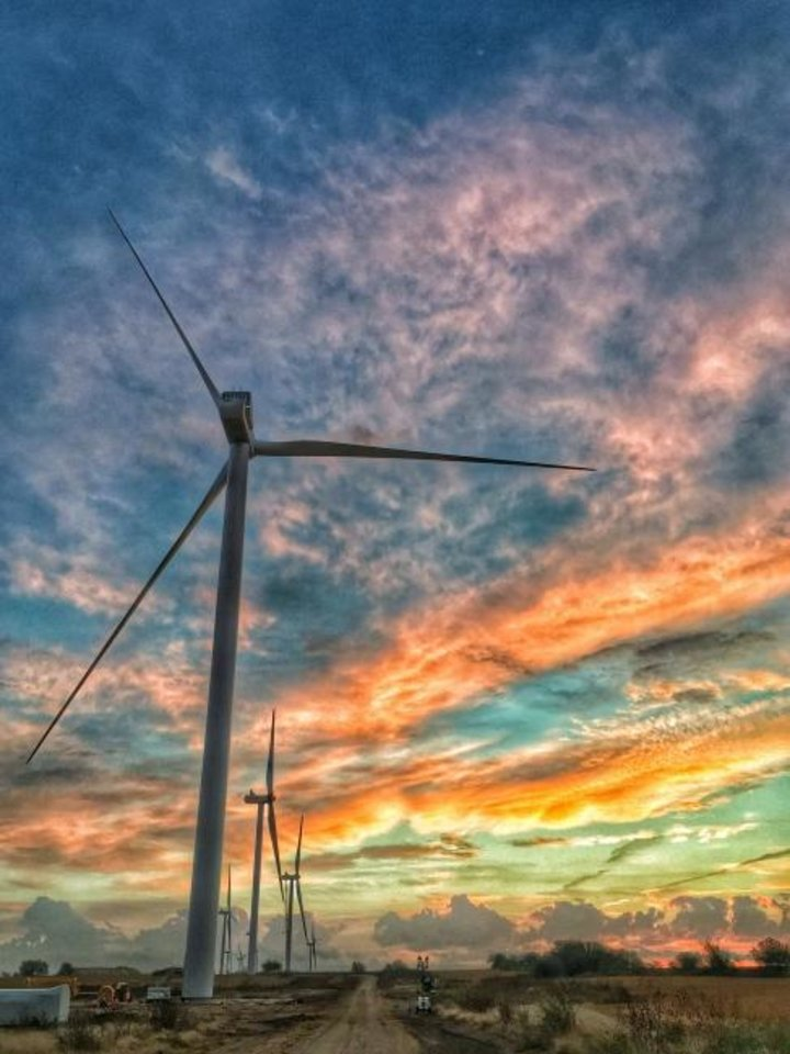 Photo -  A sunrise in Kay County shows turbines making up Duke Energy Renewables' Frontier Windpower development, which became operational in 2016. The company now is building a second phase of the project, announcing a second power purchase agreement connected to the project this week. [OKLAHOMAN ARCHIVES]