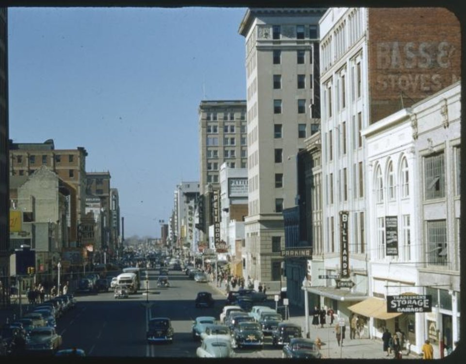Photo -  The Criterion Theater can be seen on the left in this 1950s photo of Main Street looking west from what is now E.K. Gaylord Boulevard. [OKLAHOMA HISTORY CENTER]