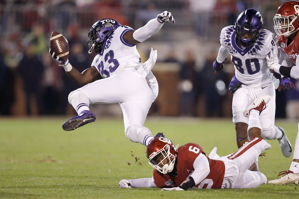 Photo - Oklahoma's Tre Brown (6) brings down TCU's Sewo Olonilua (33) during an NCAA football game between the University of Oklahoma Sooners (OU) and the TCU Horned Frogs at Gaylord Family-Oklahoma Memorial Stadium in Norman, Okla., Saturday, Nov. 23, 2019. [Bryan Terry/The Oklahoman]