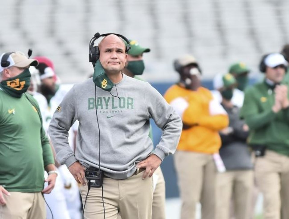 Photo -  Coach Dave Aranda and Baylor will now host Oklahoma State on Dec. 12 after COVID-19 issues led to the postponement of Saturday's scheduled game in Waco, Texas. [William Wotring/The Dominion-Post via AP]