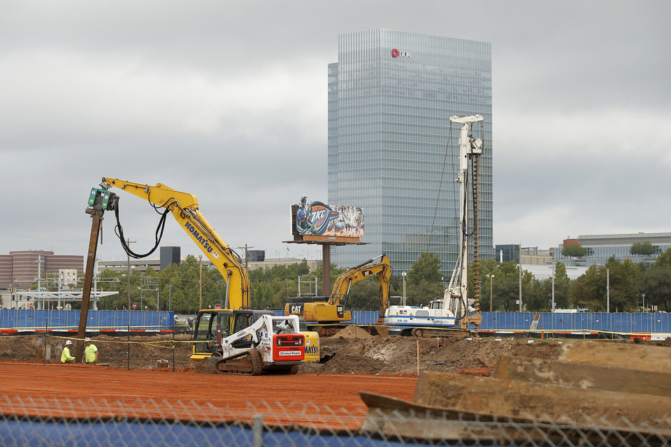 Photo - Construction continues at the site of a new Omni Hotels & Resorts 17-story, 605 room hotel before a ground breaking ceremony for the new Omni hotel in Oklahoma City, Monday, Oct. 1, 2018. Photo by Bryan Terry, The Oklahoman