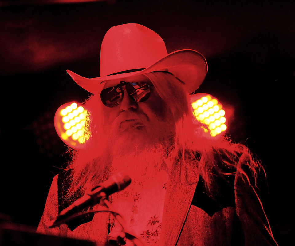 Photo - Tulsa musician and recording artist Leon Russell thrilled an energized audience for a little more than an hour Sunday night, April 25, 2010, when he performed on the Jaegermeister stage at Norman's Music Festival in downtown Norman. Photo by Jim Beckel, The Oklahoman ORG XMIT: KOD