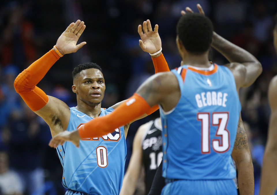 Oklahoma City Thunder guard Russell Westbrook (0) celebrates with Paul  George (13) during the second half of the team s NBA basketball game  against the San ... 430d57e71