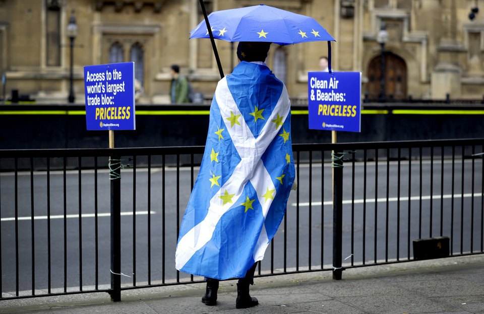 Photo -  An anti-brexit campaigner stands opposite Parliament in London, Monday, Sept. 9, 2019. British Prime Minister Boris Johnson voiced optimism Monday that a new Brexit deal can be reached so Britain leaves the European Union by Oct. 31. (AP Photo/Kirsty Wigglesworth)