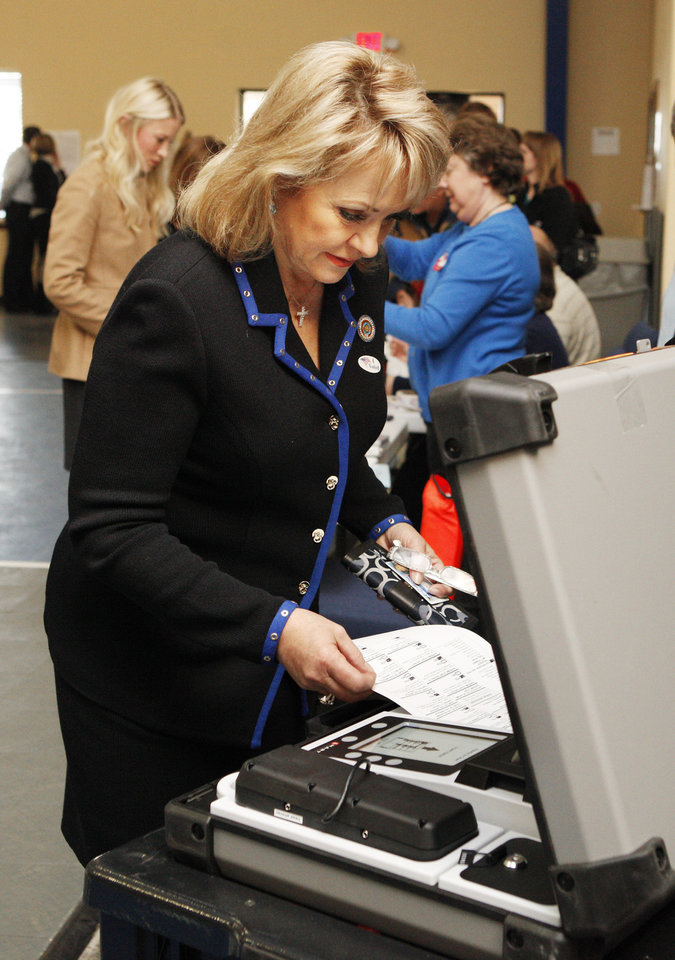 Photo - Gov. Mary Fallin places her ballot in the voting machine at precinct 137 in Oklahoma City Tuesday, Nov. 6, 2012.  Photo by Paul B. Southerland, The Oklahoman