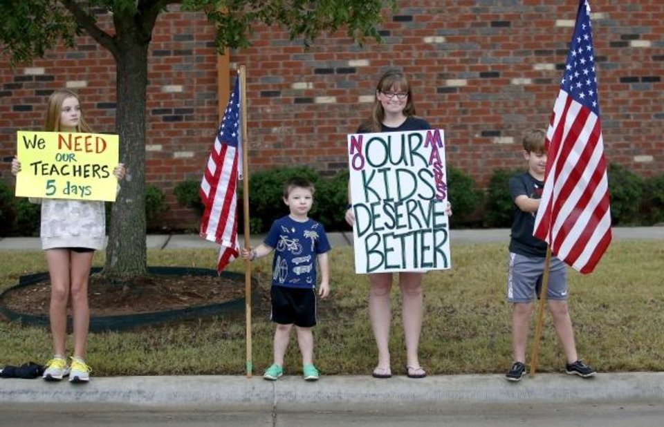 Photo -  Children join parents and supporters during a rally Wednesday for five-day school weeks in Edmond Public Schools. [Sarah Phipps/The Oklahoman]