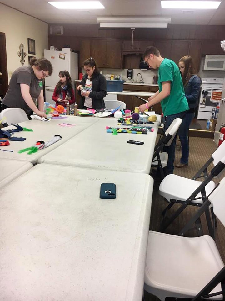 Photo - Cleveland County 4-H members host a workshop in Norman to make crazy sock puppets for World Down Syndrome Day. [PHOTO PROVIDED]