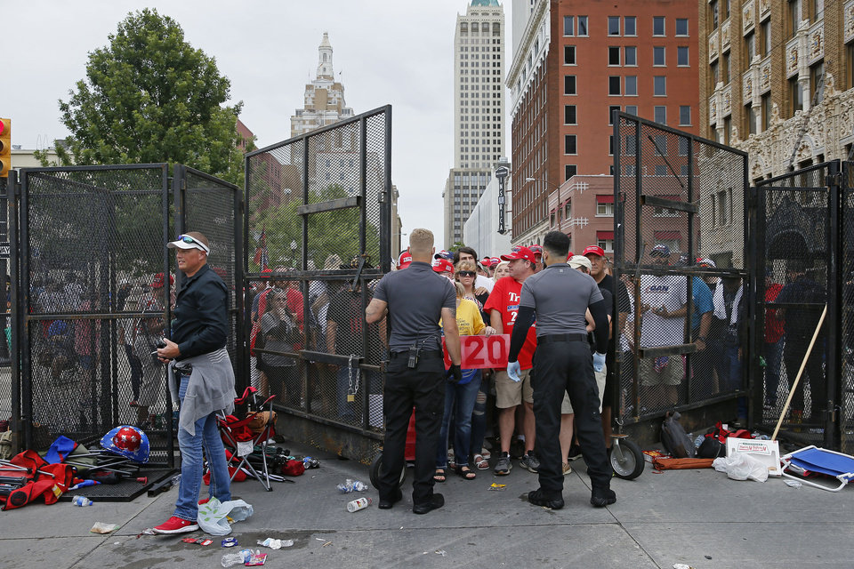 Photo - President Donald Trump supporters are let inside a gate before a rally at the BOK Center in Tulsa, Okla., Saturday, June 20, 2020. [Bryan Terry/The Oklahoman]