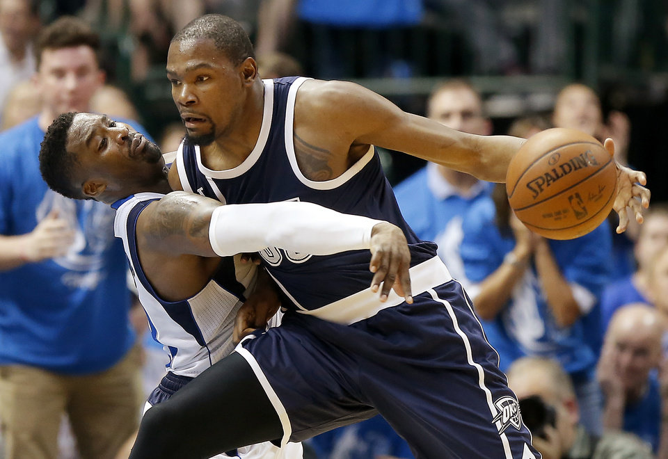 Photo - Oklahoma City's Kevin Durant (35) tries to get past Dallas' Welsey Matthews  during Game 3 of the first round series between the Oklahoma City Thunder and the Dallas Mavericks in the NBA playoffs at American Airlines Center in Dallas, Thursday, April 21, 2016. The Thunder won 131-102. Photo by Bryan Terry, The Oklahoman