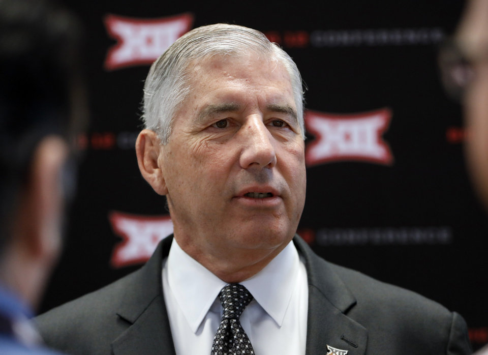 Photo - Conference commissioner Bob Bowlsby answers questions from reporters after his opening remarks on the first day of Big 12 Conference NCAA college football media days Monday, July 15, 2019, at AT&T Stadium in Arlington, Texas. (AP Photo/David Kent)
