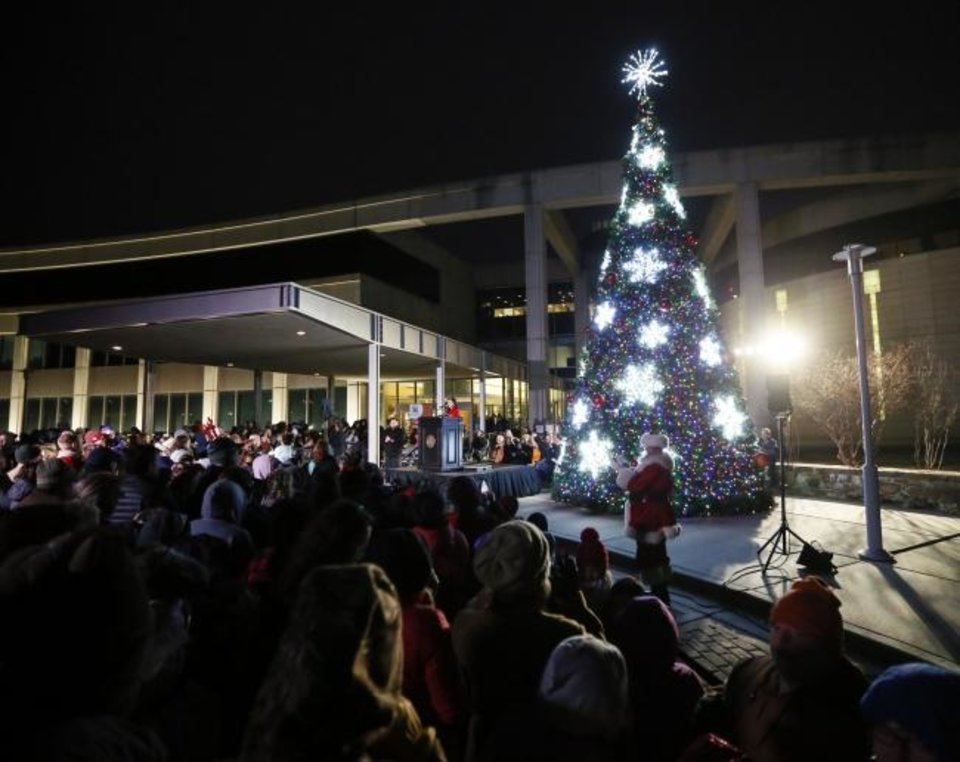 Photo -  The tree is lit during the Governor's Christmas Tree Lighting at the Oklahoma History Center in Oklahoma City, Monday, Dec. 9, 2019. [Nate Billings/The Oklahoman]