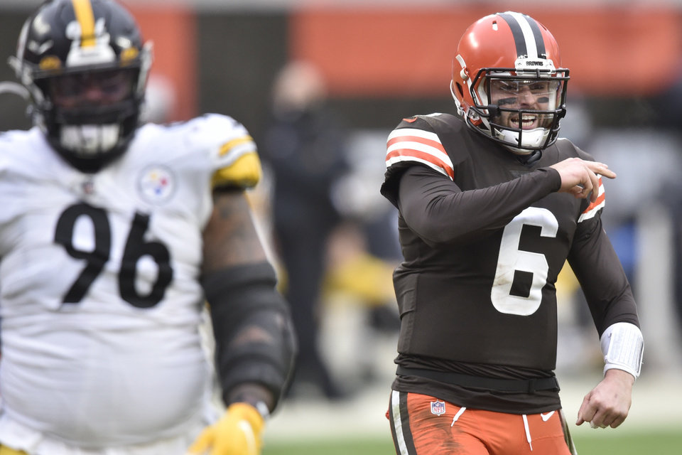 Photo - Cleveland Browns quarterback Baker Mayfield celebrates a touchdown pass in the third quarter of an NFL football game against the Pittsburgh Steelers, Sunday, Jan. 3, 2021, in Cleveland. The Browns won 24-22. (AP Photo/David Richard)