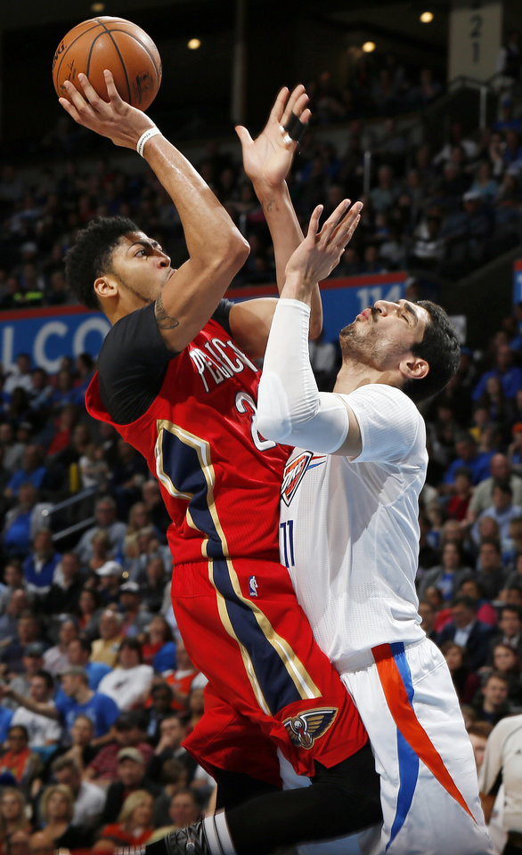 Photo - New Orleans' Anthony Davis (23) shoots against Oklahoma City's Enes Kanter (11) during an NBA basketball game between the New Orleans Pelicans and the Oklahoma City Thunder at Chesapeake Energy Arena in Oklahoma City, Thursday, Feb. 11, 2016. Oklahoma City won 121-95. Photo by Nate Billings, The Oklahoman