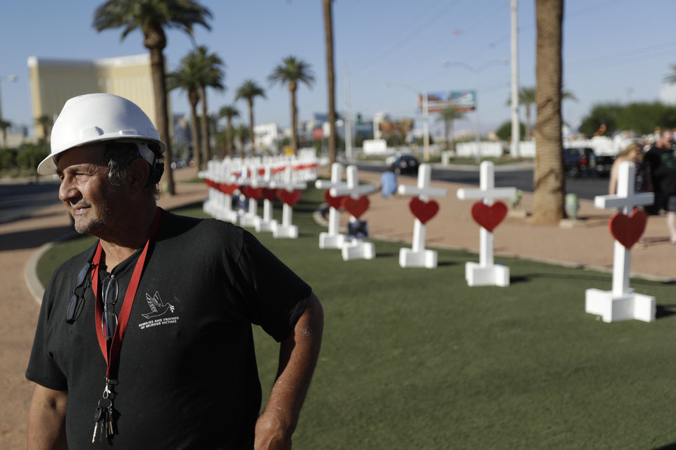 Photo - Greg Zanis stands in front of crosses he brought to Las Vegas to honor those killed during the mass shooting on Oct. 1.  (AP Photo/Gregory Bull)